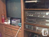 Make me a deal! Older Oak trimmed home entertainment.