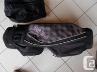 Ping golf bag in new condition with rain cover.