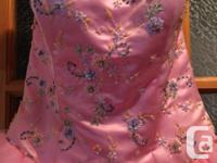 I am selling my pink prom dress. It is a size 8. Used