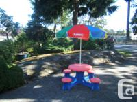 Four seat plastic table , ideal for young children. Can