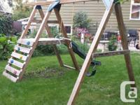 Includes slide, swing, trapeze bar & climbing wall. All