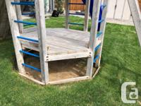 Two level cedar play structure with slide, climbing