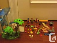 This Playmobil Animal Care Center includes: - 3