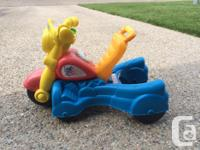 -Electronic Walk N Roll Rider toy features musical