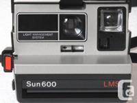 Polaroid Sun 600 LMS Camera and film Polaroid Sun 600