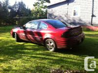 Make Pontiac Model Grand Am Year 2002 Colour red kms