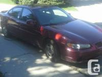 Pontiac Grand Prix SE. 3.1 L V 6. Maroon colour with