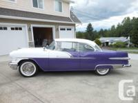 Make. Pontiac. Year. 1956. Colour. White/Purple. kms.