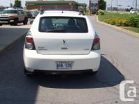 Make Pontiac Model Vibe Colour white Trans Manual kms