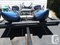 Pontoon Boat & Trailer: The boat is a Outcast Discovery