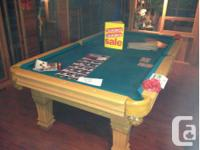 Brand new pool table complete with new cue sticks and