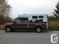 2013 Palomino Bronco B1200 pop up truck camper.