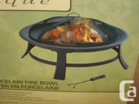Round fire bowl with black finish. Durable steel