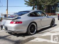 silver 2000 Porsche 911. Factory aero package, RUF coil
