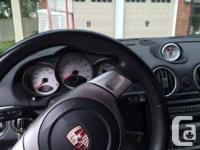Make Porsche Model Cayman Year 2006 Colour Metallic