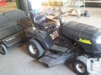 Poulin lawn tractor with lawn sweep. Mower is 5 years