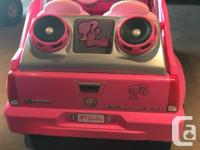 The Power Wheels Barbie Cadillac Escalade provides all
