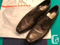 Authentic PRADA men's brown leather dress shoes. Used