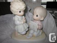 An adorable figurine from the Precious Moments wedding