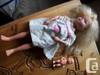 doll has a extra stomack skin to hide baby underneath.