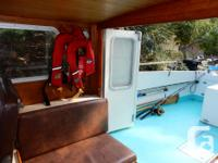 21 foot Tollycraft. Mahogany lapstrake hull. Volvo 130
