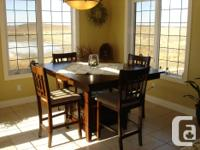 Pub style, 9-piece walnut finish table and chairs. The
