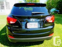Make Hyundai Model Tucson Colour Black Trans Automatic