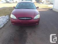 Make Ford Model Taurus Year 2002 Colour red Trans