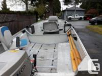 14 feet aluminum boat with trailer and motor. The boat