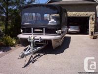 23' Pontoon boat with full enclosure. Has 2 biminis,
