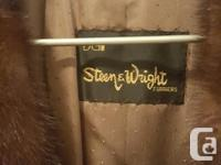 THIS MINK COAT, MADE IN CANADA, WAS PURCHASED AT STEEN