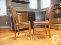 These chairs are made of solid oak and have at least