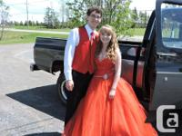 Beautiful red prom gown with a sweetie neck-line as