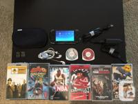 PSP with games, movies, headphones, case, charger and 2