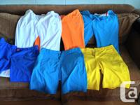 A large collection of colorful high end puma golf pants