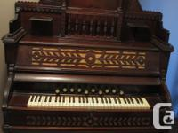 Elaborately decorated pump organ for sale. Great