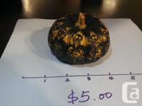 Pumpkins with a black coating and orange designs. Great