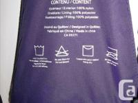 In mint condition! Purple snow pants with 1 big pocket