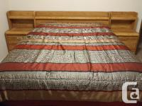 Wood queen bed in great condition. It comes with box