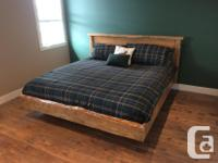 This Queen Slab Wood bed has a platform set underneath
