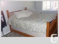 SOLID OAK ,VERY MODERN,NEAR MINT CONDITION,AND THIS BED