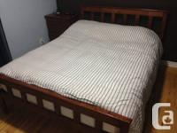 Queen-size wooden bed frame - $250.00  For queen-size