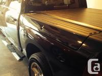 Year 2011 Colour Black Fully loaded Dodge Ram 1500.