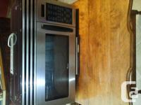 Over the stove range microwave. Very good condition,