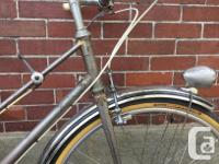 This French touring bicycle is old and heavy, with not