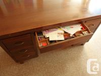 This mid-century desk is solid hardwood and was