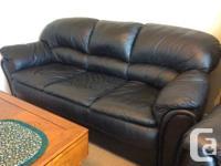 Beautiful genuine black leather-made sofa