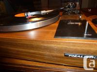 This is a beautiful Realistic Lab-250 Turntable. It is