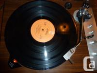 This is a gorgeous Realistic RD-8100 Turntable. It is a
