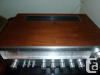 This is a beautiful wood cased, aluminum front, vintage